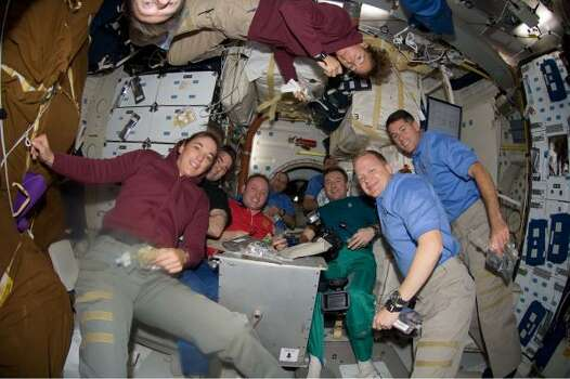 The 7 Endeavour astronauts and 3 Expedition 18 crew members share a Thanksgiving meal on the middeck of the orbiter on Nov. 27. Photo: NASA, AP