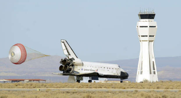 A parachute deploys as the space shuttle Endeavour touches down at Edwards Air Force Base on Nov. 30. Photo: Mark J. Terrill, AP