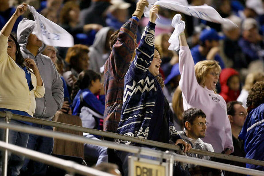 Dickinson fans put the spirit towels to good use. Photo: Diana L. Porter, For The Chronicle