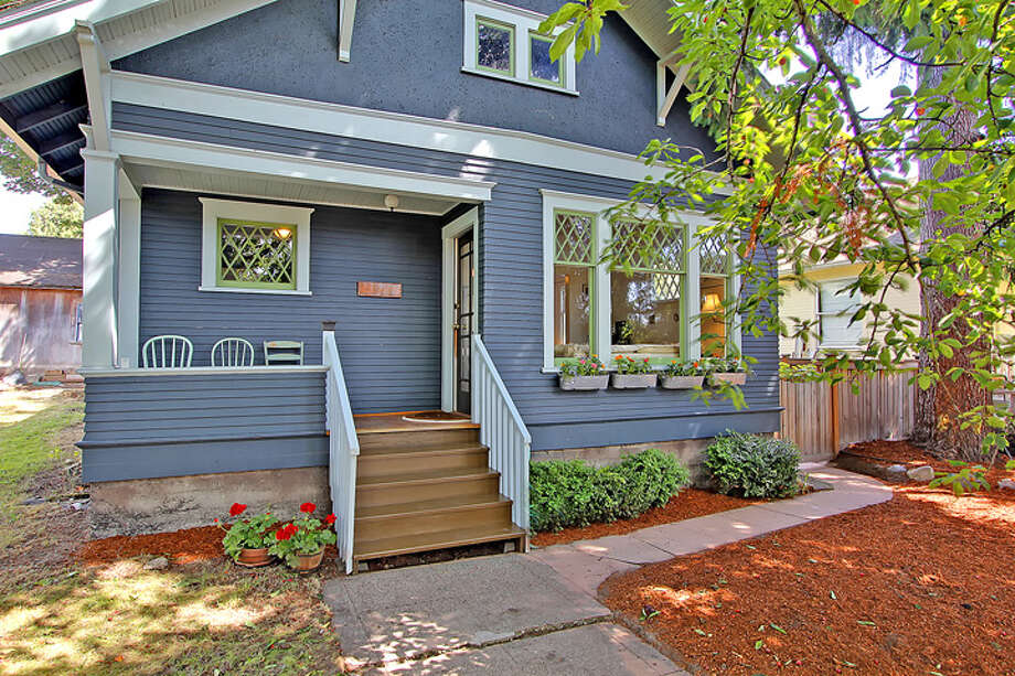 """Frelard"" is a name given to the area between Fremont and Ballard, with convenient access to both. Here are a few homes there ranging up to $450,000, starting with this 1901 house at 4412 6th Ave. N.W., listed for $349,000. The 1,026-square-foot home has two bedrooms and one bathroom, plus leaded-glass windows, a free-standing wood-burning fireplace and a detached office on the 4,000-square-foot lot. (Listing: www.windermere.com/index.cfm?fuseaction=listing.listingDetailUpdated&listingID=130556109) Photo: Windermere Real Estate"