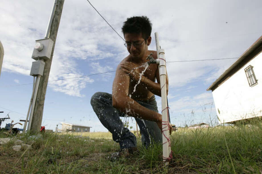 The Colonia called La Pinata in McAllen, Tx has running water and electricity, so people are moving into the area with their trailers and hoping to build their houses on their lots. Photo: Julio Cortez, Chronicle