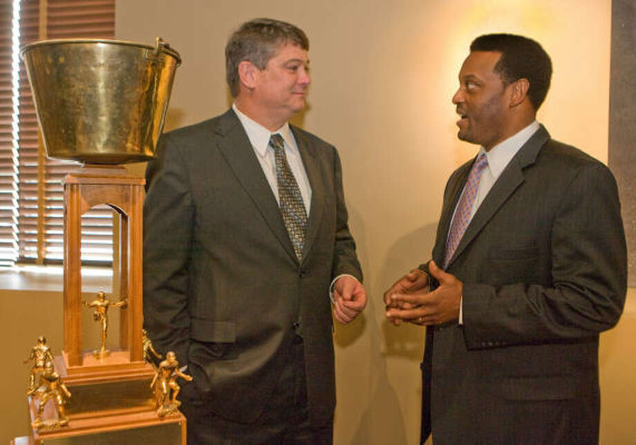 It's good that Rice coach David Bailiff and UH coach Kevin Sumlin are on hand to take attention away from the Bayou Bucket. The trophy — which looks like it has taken a few shots from a BB gun — will be won on Saturday afternoon. Photo: Steve Campbell, Chronicle