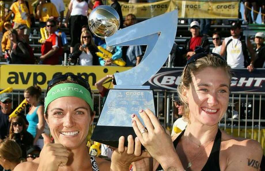 Nothing says volleyball title like this thing. Misty May-Treanor (with green headband) and  Kerri Walsh picked it up at an AVP event in San Francisco. Photo: Christian Petersen, Getty Images