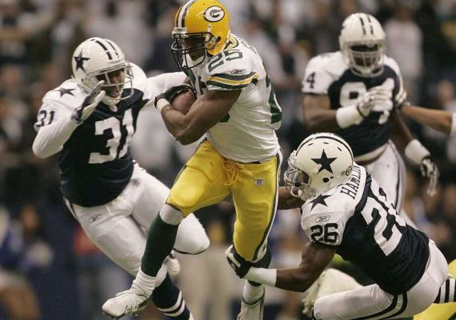 Ryan Grant of Green Bay scampers toward the end zone in a game against the Dallas Cowboys on Nov. 29, a game that many football fans couldn't see without subscribing to the NFL Network. Photo: KHAMPHA BOUAPHANH, FORT WORTH STAR-TELEGRAM