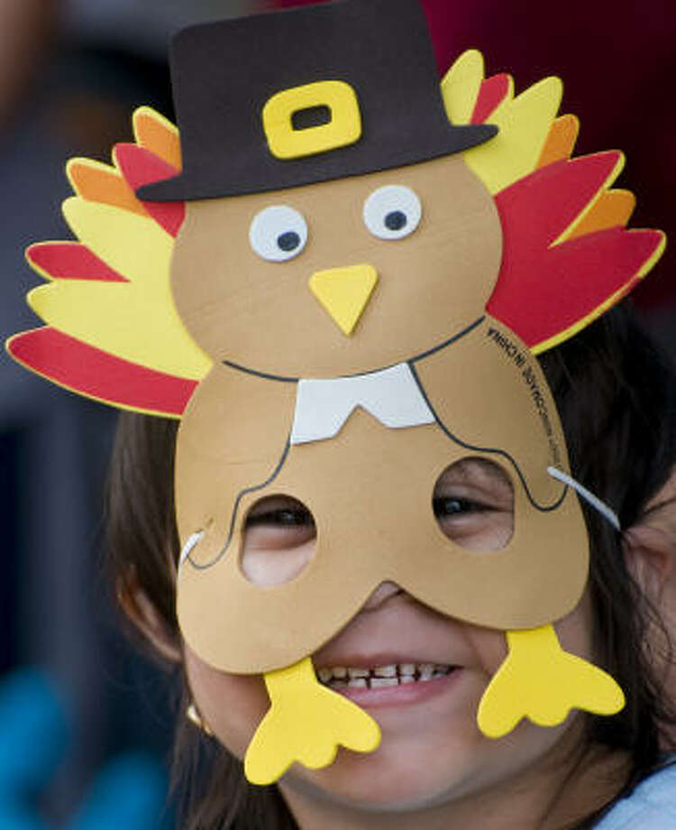 A young spectator watches as the 59th annual Thanksgiving Day Parade winds its way through downtown Houston. Photo: Steve Ueckert, Chronicle