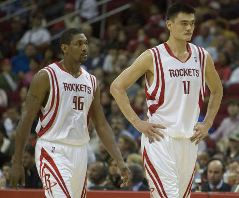 Forward Ron Artest (left) and center Yao Ming led the Rockets with 19 points apiece, but they could not stop Houston from dropping a 91-90 decision to the Indiana Pacers on Wednesday night at Toyota Center. Photo: James Nielsen, Chronicle