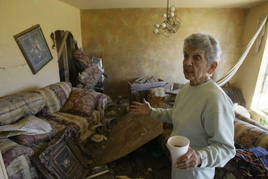 Edna Henson stands in her home damaged in Hurricane Ike in Galveston.  For the first time in 46 years she will not be having Thanksgiving at her home on Pruitt Drive. She does not want to rebuild  the home or even live on Galveston again. Photo: Melissa Phillip, Houston Chronicle