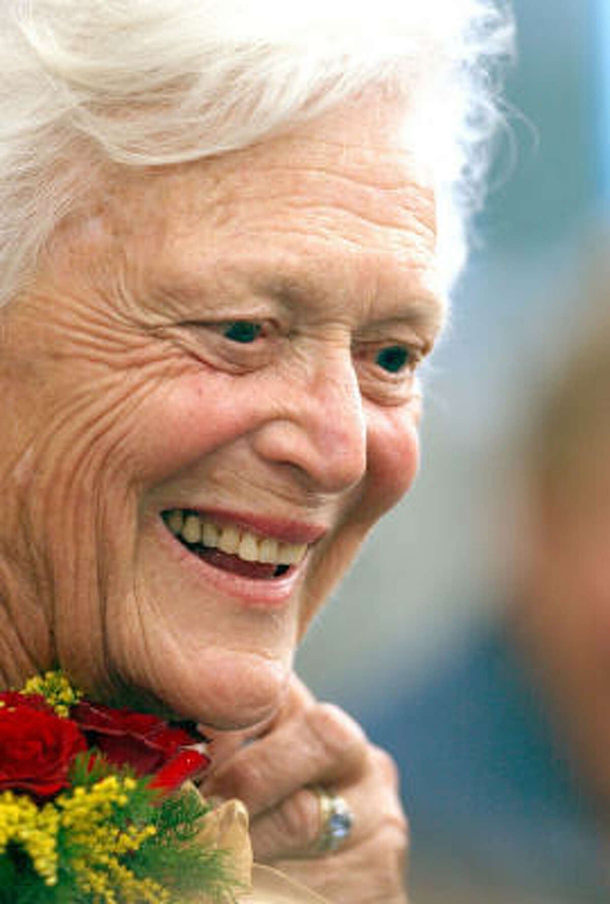 Former First Lady Barbara Bush smiles at a student during a visit to Gaffney Elementary School in New Britain, Conn., Sept. 8, 2003, part of her efforts to promote literacy.