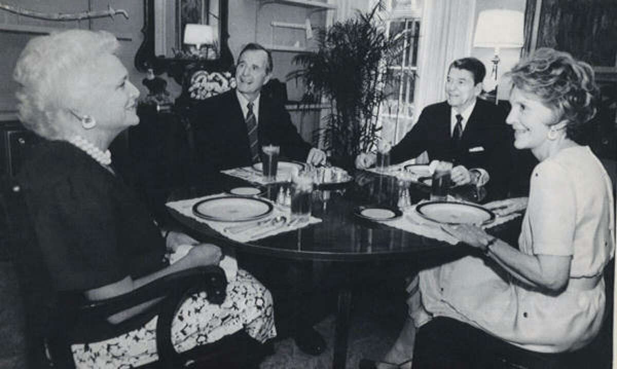 Barbara Bush, left, and Nancy Reagan sit with their husbands, Vice President George Bush and President Reagan during a luncheon at the White House in 1988.
