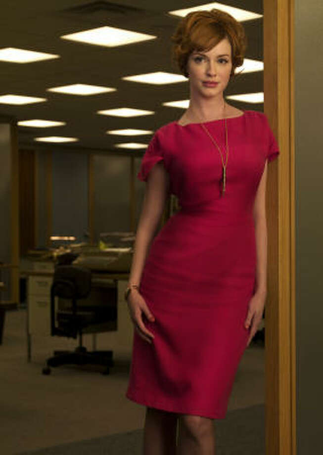 THE BOMBSHELL: As Joan Holloway, the woman in charge of the secretarial pool on AMC's mega-hit Mad Men, actress Christina Hendricks manages the Sterling Cooper office with an iron will and a formidable brassiere. Photo: AMC