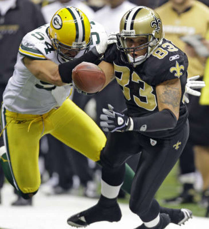 New Orleans Saints tight end Billy Miller (83) is knocked out of bounds by Green Bay Packers' Brandon Chillar (54) during the first half. Photo: Alex Brandon, AP