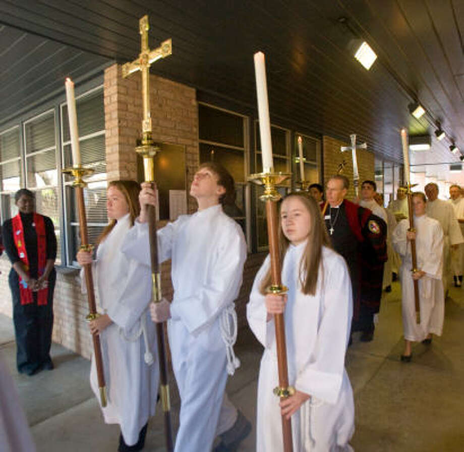 Acolytes participate in the procession for the consecration of the Reverend C. Andrew Doyle who was ordained and consecrated as Bishop Coadjutor in the Episcopal Diocese of Texas at St. Martin's Church. Photo: Steve Campbell, Houston Chronicle