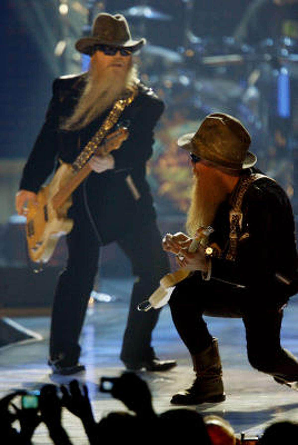 Dusty Hill, left, and Billy Gibbons perform Saturday during the VH1 Rock Honors in Las Vegas. ZZ Top has canceled its European tour so Hill can undergo treatment for acoustic neuroma, a benign growth in his inner ear.