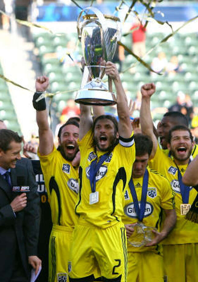 Crew 3, Red Bulls 1Frankie Hejduk, captain of the Columbus Crew holds up the Philip F. Anschutz trophy after defeating the New York Red Bulls 3-1 to win the 2008 MLS Cup. Photo: Jeff Gross, Getty Images