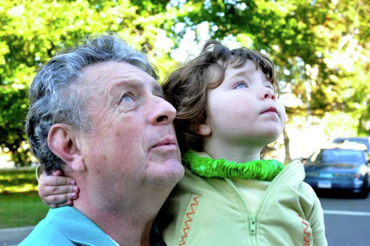 City Councilman Peter Nero and his granddaughter, Nicolena Carmella LeRose, 3, watch the Italian flag being raised outside Danbury City Hall, Saturday, Oct. 9, 2010.