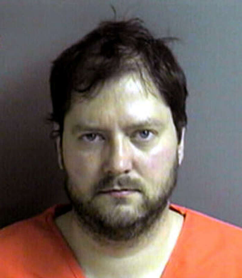 While searching the apartment of Michael Devlin, 41, pictured, in the St. Louis suburb of Kirkwood, authorities found 13-year-old Ben Ownby and 15-year-old Shawn Hornbeck. Photo: AP