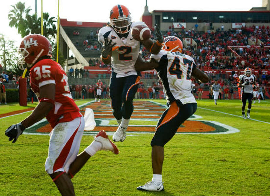Houston 42, UTEP 37 UTEP defensive back Josh Ferguson (2) nearly intercepts a pass intended for Houston wide receiver Tyron Carrier (35) in the end zone as UTEP defensive back Cornelius Brown (47) joins on defense. Photo: Smiley N. Pool, Houston Chronicle