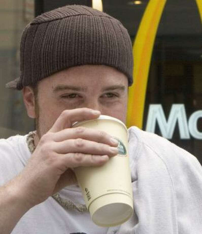 Paul Landry has coffee in Cambridge, Mass. Photo: JB REED, BLOOMBERG NEWS