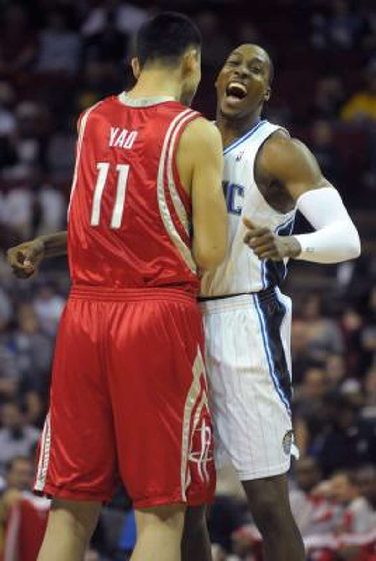 Dwight Howard (right) had a few battles with Yao Ming when the former played in Orlando.