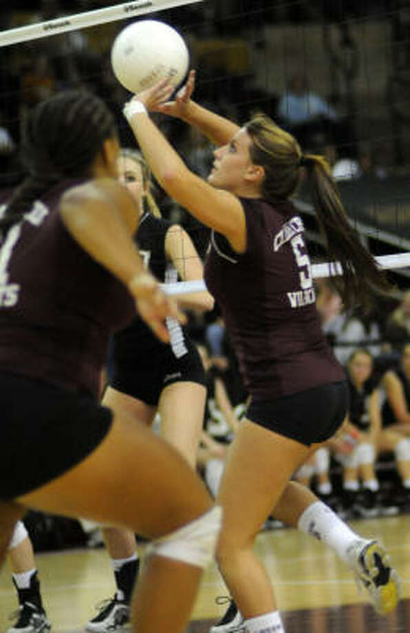 Clear Creek senior setter Becky Bekelja (right) sets a ball for teammate Taylor Smith (in foreground) during Friday's Class 5A state volleyball semifinal versus Amarillo at Strahan Coliseum on the campus of Texas State University in San Marcos. Amarillo won 3-2. Photo: Jerry Baker, For The Chronicle