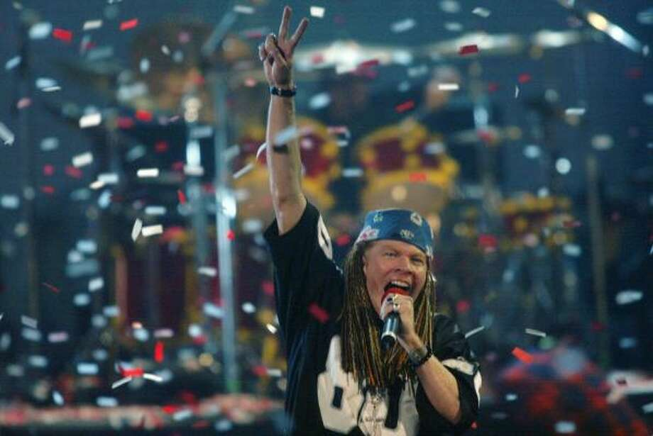 Axl Rose, lead singer for the band Guns N' Roses, performs during the MTV Video Music Awards in 2002. Photo: BETH KEISER, Associated Press
