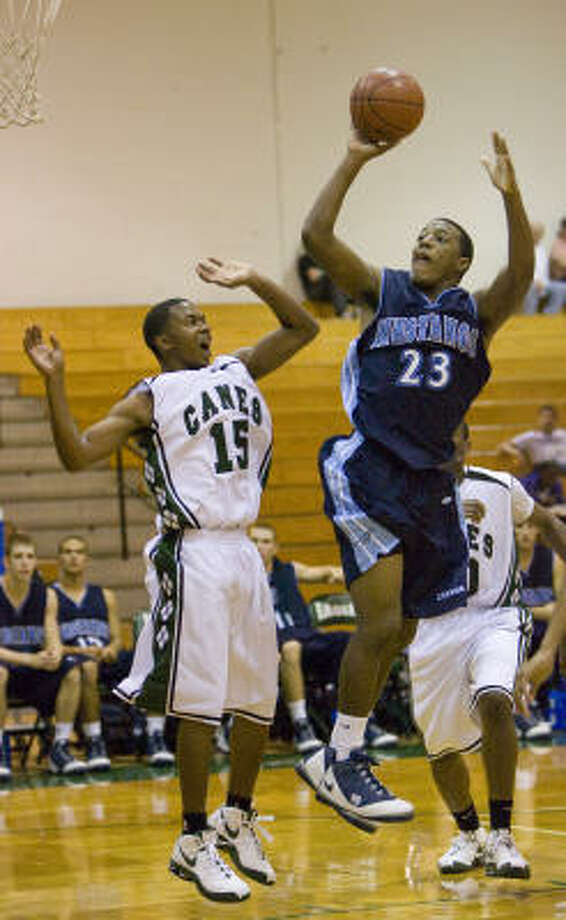 Kingwood's Robert Singletary (23) shoots over Hightower's Joshua Thomas (15) in Thursday's game at the Texas Invitational Tournament at Pasadena High School. Kingwood knocked off top-ranked Hightower 58-42. Photo: Steve Campbell, Chronicle
