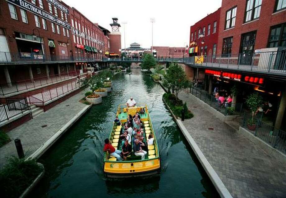 Bricktown, part of Oklahoma City's downtown revitalization program, features, shops and water taxi rides on a canal. Photo: TOM UHLENBROCK, KRT File