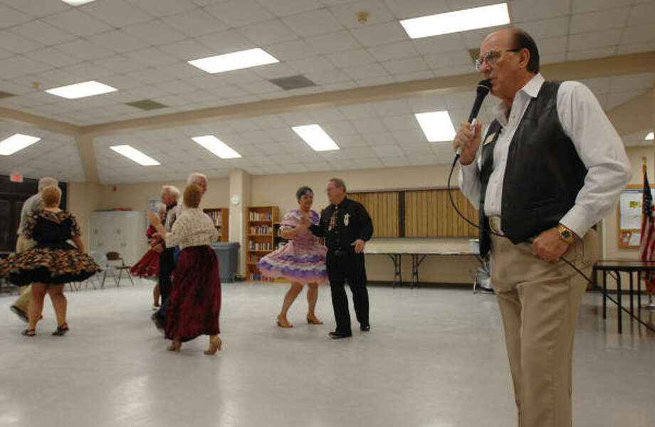 Wade Driver calls square dances at the South County Community Center in The Woodlands for The Woodlands Stars, a local square dancing group that meets weekly. Photo: Thomas Nguyen, For The Chronicle