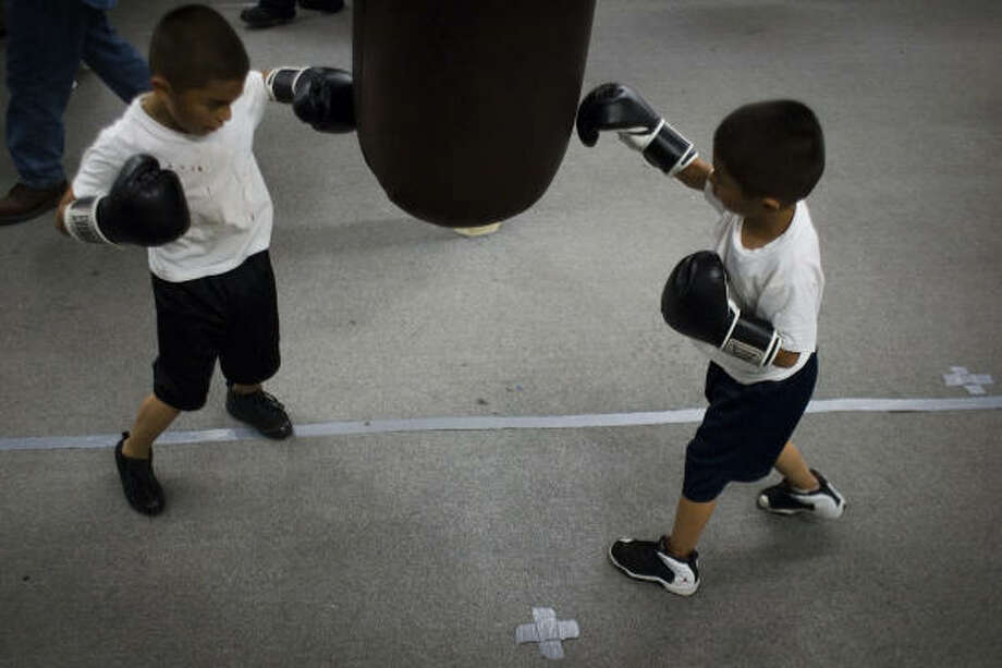 Daniel Figueroa, 7, left, and his twin Jonathan Figueroa work out at Savannah Boxing Club. Photo: Smiley N. Pool, Chronicle