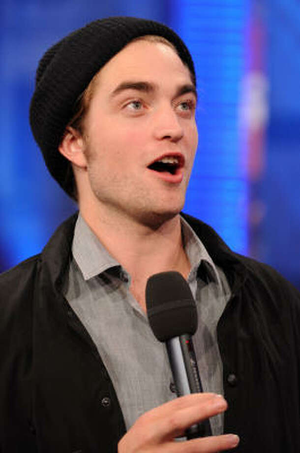 Pattinson plays guitar. Edward plays piano. Photo: Bryan Bedder, Getty Images