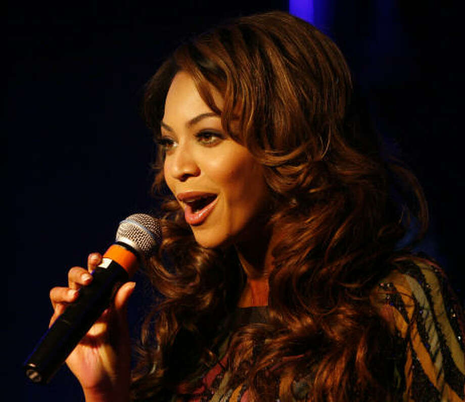 Singer and Houston native  Beyoncé Knowles  speaks during a news conference today at her downtown studio. Photo: Billy Smith II, CHRONICLE