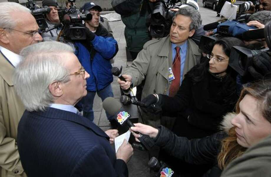 David Stockman, left, former budget director during the Reagan administration, speaks to reporters outside Manhattan federal court on Monday. Stockman was charged with fraud for his role in the collapse of an auto parts supply company. Photo: LOUIS LANZANO, ASSOCIATED PRESS