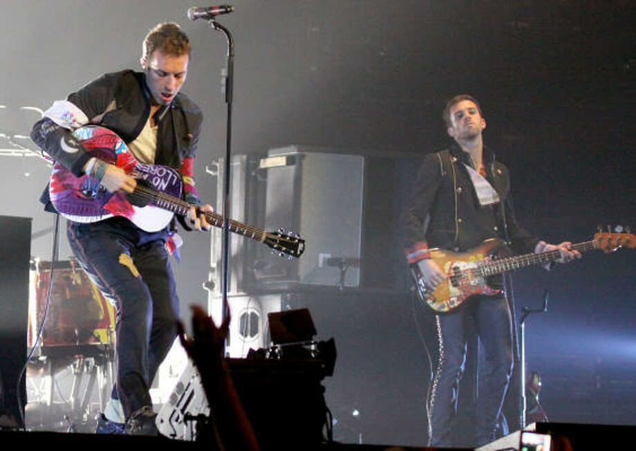 Musician Guy Berryman (right), who is the bassist for Coldplay. Photo: Bill Olive, HOUSTON CHRONICLE