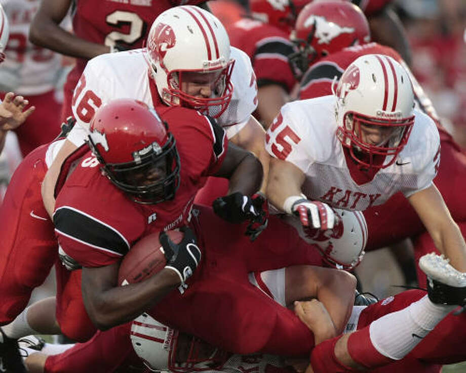 North Shore 10, Katy 6 North Shore running back Tracy Woods (w/ball) can't get away from this group of Katy defenders in the first half. Photo: BILLY SMITH II, HOUSTON CHRONICLE