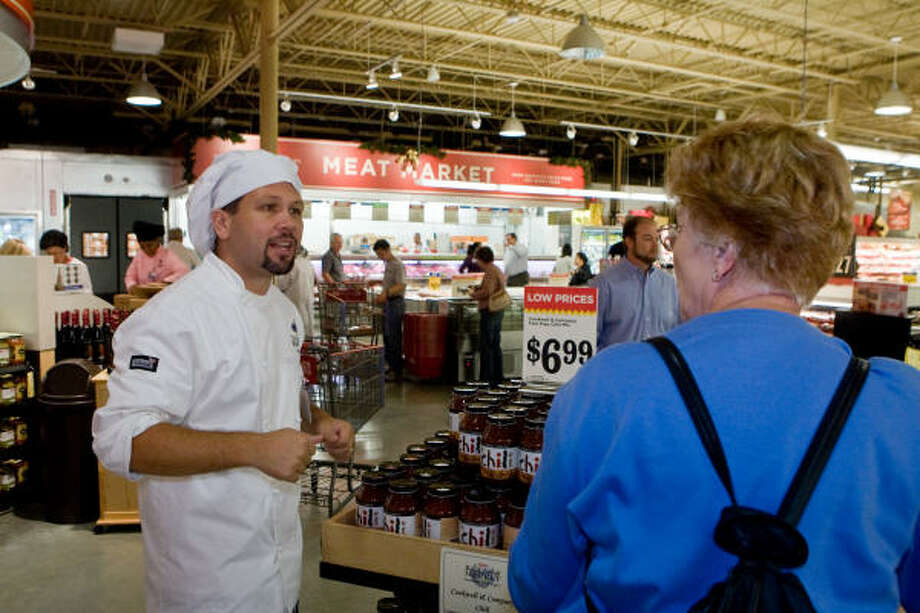 NEW H-E-B:Chef Sean Robertson gives a customer directions at the grand opening of the new Spring Branch H-E-B on Katy Freeway. Photo: R. Clayton McKee, For The Chronicle