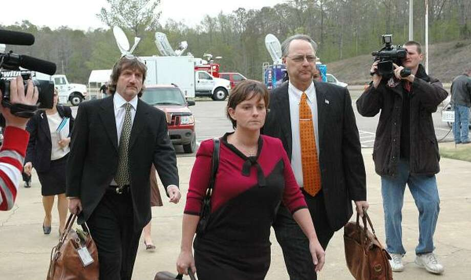 Mary Winkler, followed by defense attorneys Leslie Ballin, left, and Steve Farese Sr., walks into McNairy County Court in Selmer, Tenn., on Monday for jury selection in her first degree trial. Winkler, 33, is accused of killling her husband, Matthew, a popular young minister who was found dead from a shotgun blast last March. Photo: Russell Ingle, AP Photo