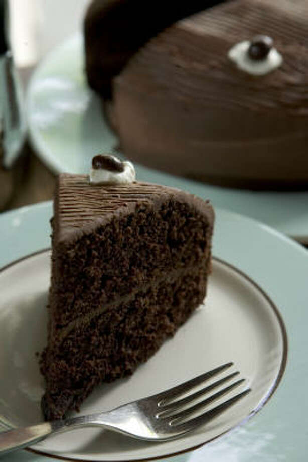 Mother's Easy Chocolate Cake is an old-fashioned layer cake best made with high-quality cocoa. Audrey Platter ($24.95) and Audrey Salad Plate ($7.95) are from Crate & Barrel. Photo: Brett Coomer, Chronicle