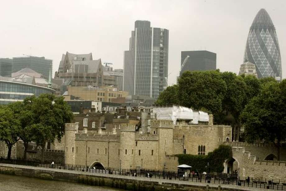 The Tower of London, built in 1078 to serve as a fortress, palace and prison, is today encircled by office buildings and skyscrapers. Photo: KIRSTY WIGGLESWORTH, AP