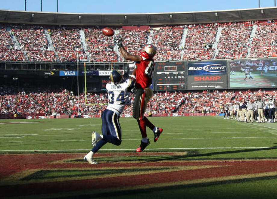 49ers 35, Rams 16 Bryant Johnson of the San Francisco 49ers catches a touchdown over Fakhir Brown of the St. Louis Rams. Mike Singletary got his first win as head coach as the 49ers snapped a six-game losing streak. Photo: Jed Jacobsohn, Getty Images