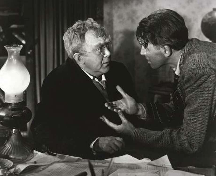 Uncle Billy, left, played by Thomas Mitchell, and George Bailey, played by James Stewart, face a Depression-era banking crisis in a scene from It's a Wonderful Life. Modern U.S. banking system rules make runs on banks an unlikely occurrence. Photo: NBC