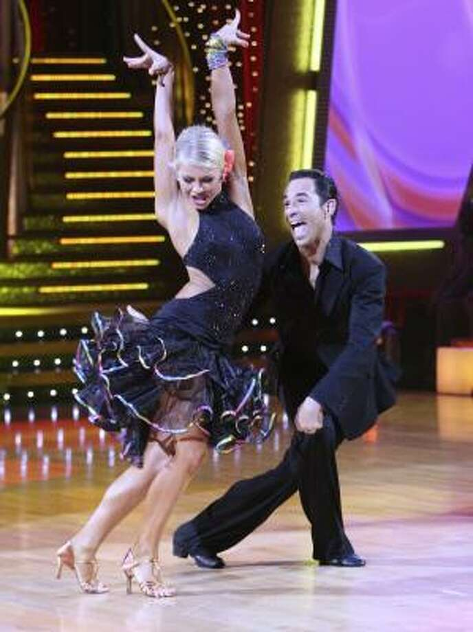 Currently on Dancing with the Stars, Helio Castroneves, a Brazilian two-time champion of the Indy 500, is partnered with Julianne Hough, a professional dancer trained in Houston. This twosome has scored well with the judges. Photo: CAROL KAELSON PHOTOS, ABC