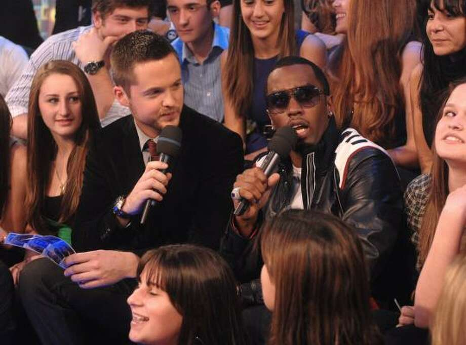 MTV VJ Damien Fahey, left, and Diddy appear on MTV's TRL Total Finale Live show at the MTV studios in Times Square in New York on Nov. 16. Photo: Peter Kramer, AP