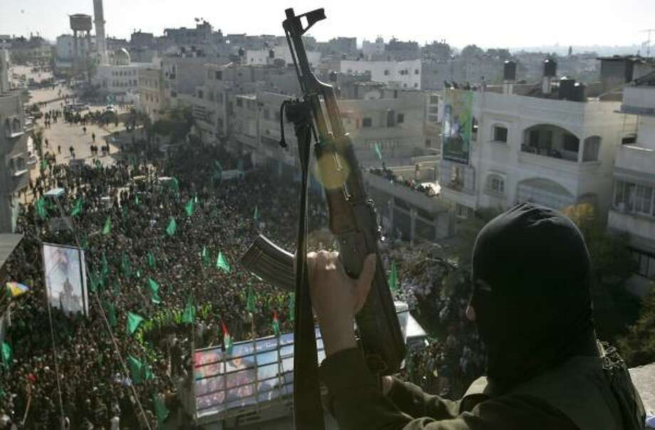 Supporters of the Hamas movement attend a rally marking the first anniversary of its victory in Palestinian elections at the Jebalia refugee camp in northern Gaza Strip on Friday. Photo: MAHMUD HAMS, AFP/GETTY IMAGES