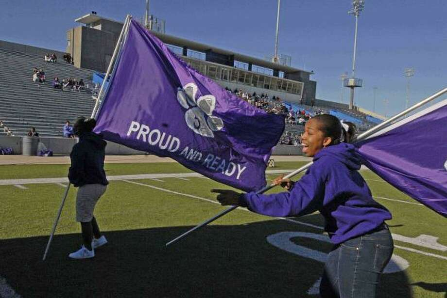 Melodie Murray runs the flag for Davis. Photo: Tony Bullard, For The Chronicle