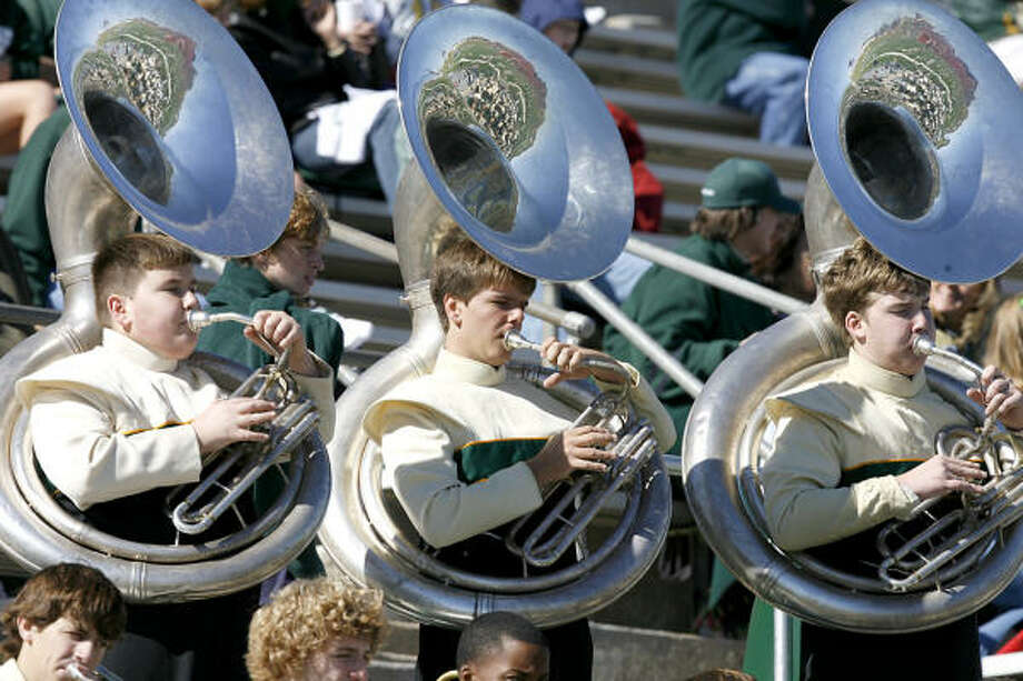 The Stratford band tuba section plays the Spartan fight song. Photo: Diana L. Porter, For The Chronicle