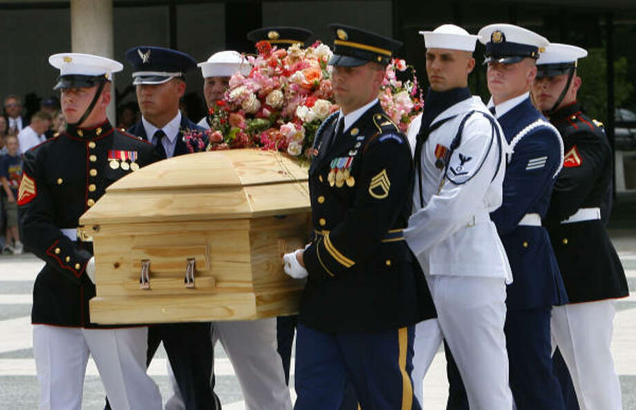 The body of Lady Bird Johnson, widow of Lyndon Baines Johnson, is carried by a military honor guard  into the LBJ Library on the campus of the University of Texas as Austin today. Photo: Steve Ueckert, Chronicle
