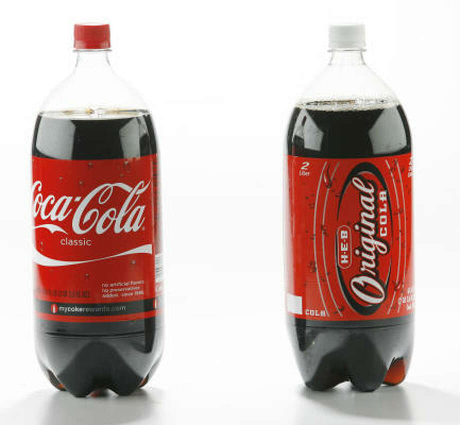 Soda: Coca-Cola costs $1.49 for a 2-liter bottle at H-E-B; H-E-B Original cola costs $1 for the same size bottle. Photo: Eric Kayne, Chronicle
