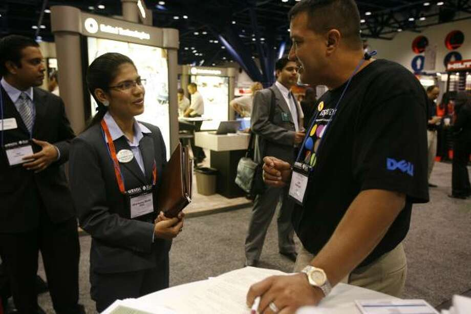 Dell's Jose Rodriguez speaks with University of Virginia MBA student Akanksha Manik Talya during the National Society of Hispanic MBAs 18th conference and job fair at the George R. Brown Convention Center on Friday. Photo: JAMES NIELSEN, CHRONICLE