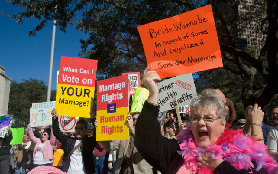 HOUSTONDeborah Bell and other demonstrators cheer in support of speakers at the protest against California's passing of Proposition 8 at City Hall. The measure banned gay marriage in California. Photo: Steve Campbell, Chronicle
