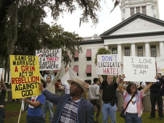 TALLAHASSEEScores of protestors protest as they marched from Florida State University to the state Capitol on Saturday to protest Amendment 2, which adds a ban on gay marriage to the Florida Constitution. Photo: Bill Cotterell, AP